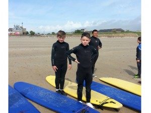 Ben, Duncan and Oisín get ready to catch some waves.